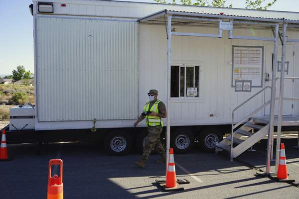 Associated Press A Nevada National Guardsman leaves a portable trailer that FEMA  designed as a mobile vaccination unit  in Fallon, Nev. The units are meant to make it easier for more people to get vaccinated.