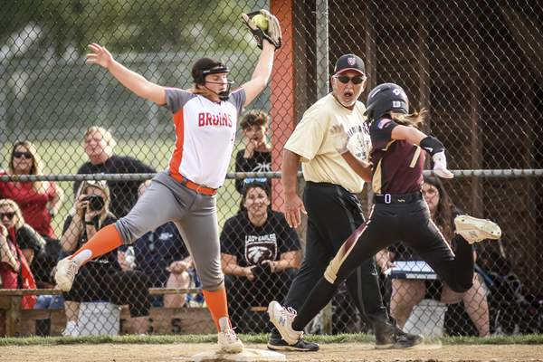 Mike Moore | The Journal Gazette Northrop first baseman Raegan Torrez makes the catch for an out in the third inning against Columbia City during the regional championship at Northrop High School on Tuesday.