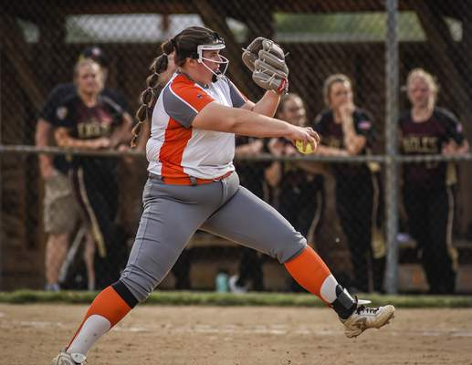 Mike Moore | The Journal Gazette Northrop pitcher Alexa Huth pitching in the third inning against Columbia City during the regional championship at Northrop High School on Tuesday.