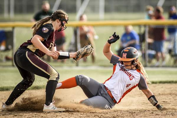 Mike Moore | The Journal Gazette Northrop first baseman Raegan Torrez slides into second base in the third inning against Columbia City during the regional championship at Northrop High School on Tuesday.