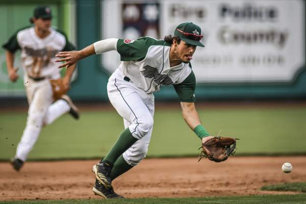 Mike Moore | The Journal Gazette TinCaps third baseman Ethan Skender scoops up a ground ball before throwing to first base for the out in the third inning against Cedar Rapids at Parkview Field on Tuesday.