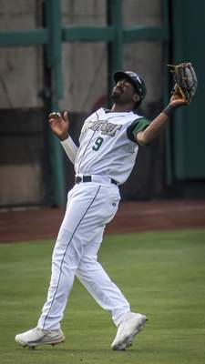 Mike Moore | The Journal Gazette TinCaps left fielder Dwanya Williams-Sutton makes a catch in the second inning against Cedar Rapids at Parkview Field on Tuesday.