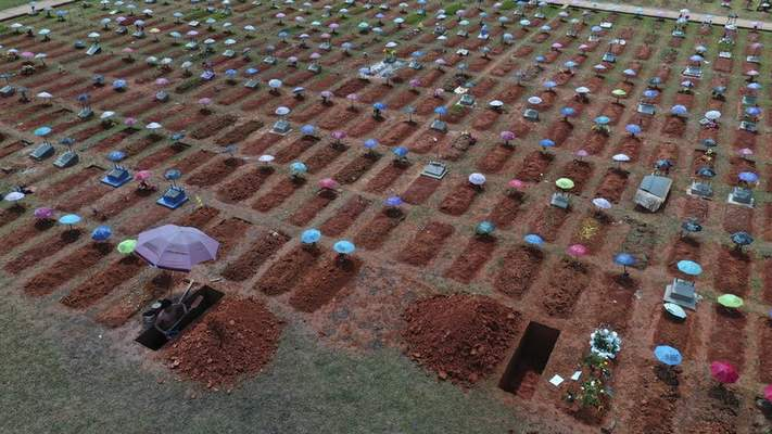 FILE - In this March 20, 2021 file photo, a worker digs a grave in the San Juan Bautista cemetery in Iquitos, Peru, amid the new coronavirus pandemic. (AP Photo/Rodrigo Abd, File)