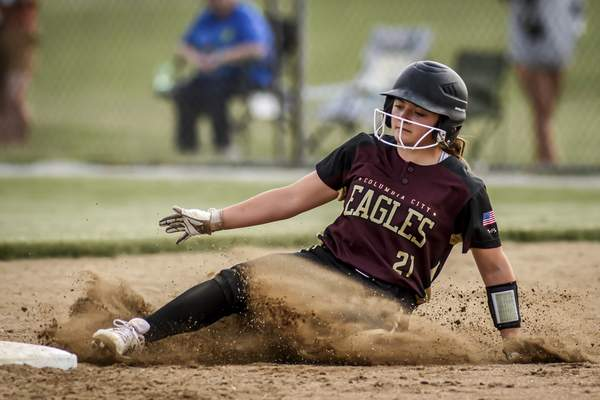 Photos by Mike Moore   The Journal Gazette Columbia City third baseman Reagan Pratt slides into second base in the third inning against Northrop during the regional championship at Northrop High School on Tuesday.