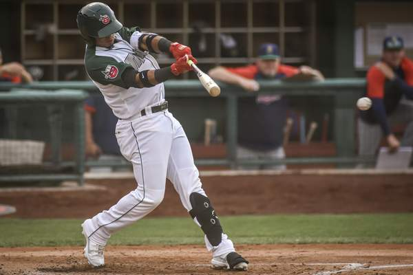 Mike Moore | The Journal Gazette TinCaps designated hitter Luis Almanzar swings in the second inning against Cedar Rapids at Parkview Field on Tuesday night.