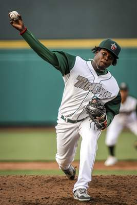 Mike Moore | The Journal Gazette TinCaps pitcher Moises Lugo throws a heater in the third inning against Cedar Rapids at Parkview Field on Tuesday.