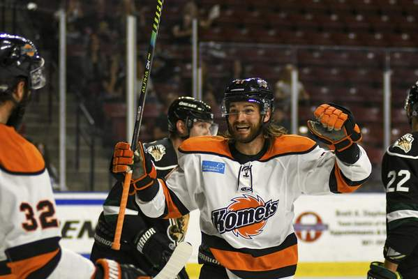 Utah Grizzlies Photography  Komets forward Marco Roy celebrates teammate Stephen Harper's first-period goal Wednesday against the Utah Grizzlies in West Valley City, Utah. Harper redirected Roy's shot to open the scoring.
