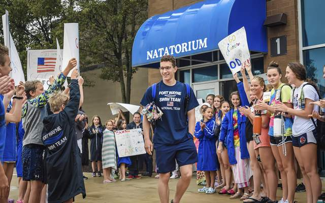 Mike Moore | The Journal Gazette Cameron Luarde receives a send-off Wednesday at Carroll Natatorium before leaving for the Olympic trials in Omaha, Neb. this week.