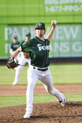 Katie Fyfe | The Journal Gazette  TinCaps pitcher Ethan Elliott pitches the ball during the second inning against the Kernels at Parkview Field on Thursday.