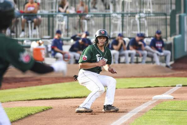 Katie Fyfe | The Journal Gazette  TinCaps' Jonny Homza watches as he runs back to third base during the first inning against the Kernels at Parkview Field on Thursday.