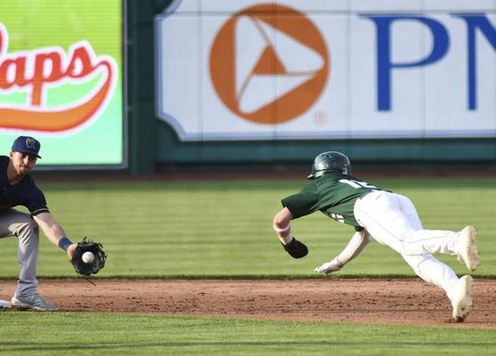Katie Fyfe | The Journal Gazette  The TinCaps' Grant Little slides into second base as the Kernels' Spencer Steer catches the ball during the second inning at Parkview Field on Thursday.