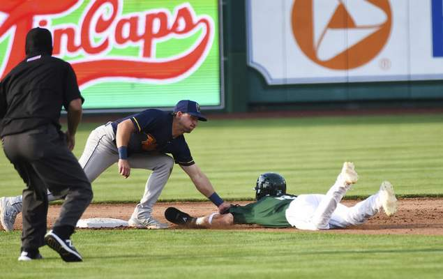 Katie Fyfe | The Journal Gazette  The TinCaps' Grant Little slides onto second base as the Kernels' Spencer Steer gets him out during the second inning at Parkview Field on Thursday.