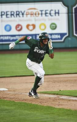 Katie Fyfe | The Journal Gazette  The TinCaps' Justin Lopez runs from third base to home during the fifth inning against the Kernels at Parkview Field on Friday.