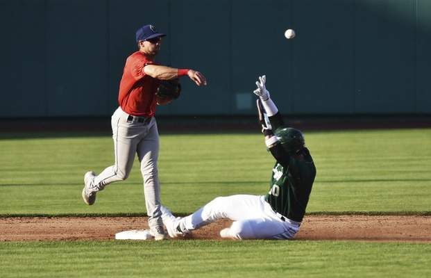 Katie Fyfe | The Journal Gazette  The TinCaps Tirso Ornelas slides into second base during the third inning against the Kernels at Parkview Field on Friday.
