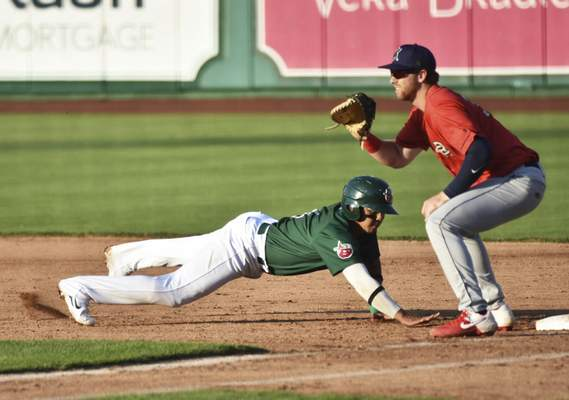 Katie Fyfe | The Journal Gazette  The TinCaps' Kelvin Melean slides back into first base during the fourth inning against the Kernels at Parkview Field on Friday.