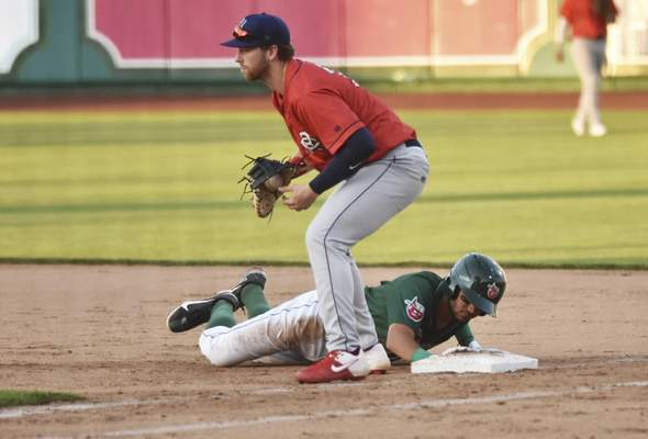 Katie Fyfe | The Journal Gazette  The TinCaps' Justin Lopez slides back into first base during the fifth inning against the Kernels at Parkview Field on Friday.