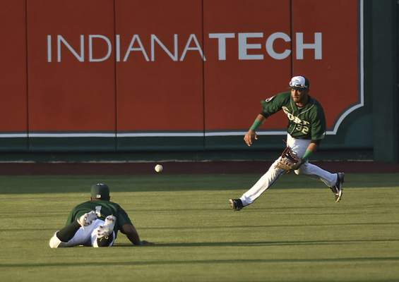Katie Fyfe | The Journal Gazette  The TinCaps' Agustin Ruiz runs to catch the ball during the fifth inning against the Kernels at Parkview Field on Friday.