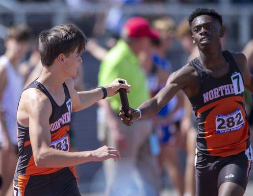 Chryzor Baltazard (282), Fort Wayne Northrop, hands off the baton to Connor Jackson (283) as the team copouts in the Boys 4x800 Meter Relay during the 117th Annual IHSAA Boys' State Track and Field Finals at Ben Davis High School, Friday, June 4, 2021. (Doug McSchooler/for Journal-Gazette)