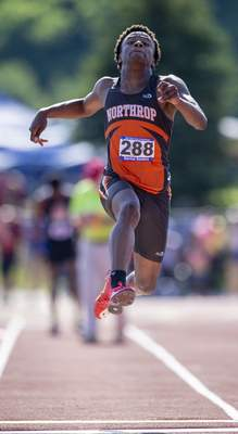 Darrius Sanders (288), Fort Wayne Northrop High School, compete in the Boys Long Jump during the 117th Annual IHSAA Boys' State Track and Field Finals at Ben Davis High School, Friday, June 4, 2021. (Doug McSchooler/for Journal-Gazette)