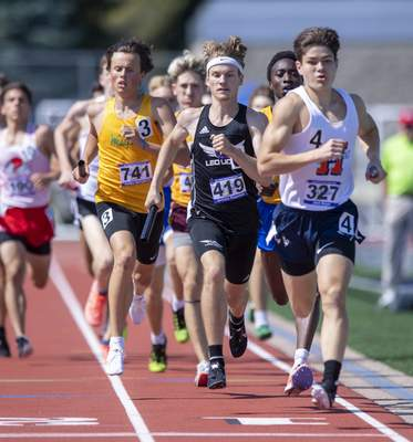 Jackson Ringwood(419), tries to maintain contact with the leaders while competing in the Boys 4x800 Meter Relay Leoduring the 117th Annual IHSAA Boys' State Track and Field Finals at Ben Davis High School, Friday, June 4, 2021. (Doug McSchooler/for Journal-Gazette)