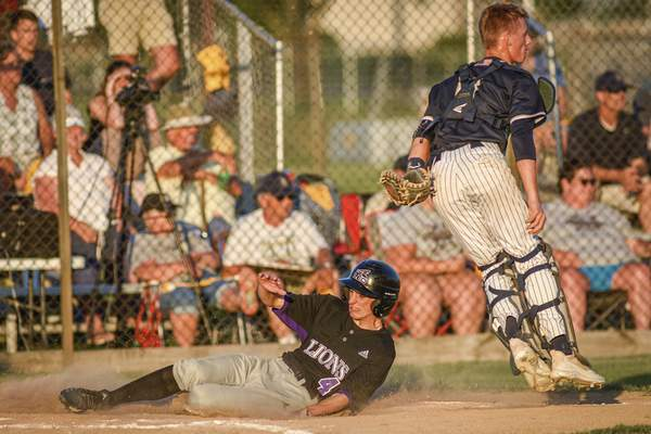 Mike Moore | The Journal Gazette Leo senior Gannon Brown slides across home plate in the second inning of the regional championship against Norwell at Bellmont High School on Saturday.