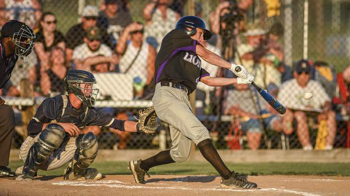 Mike Moore | The Journal Gazette Leo senior Gannon Brown at bat in the second inning against Norwell during the regional championship at Bellmont High School on Saturday.