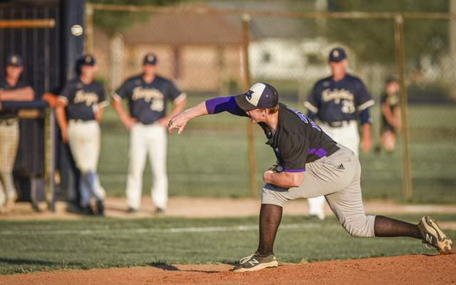Mike Moore | The Journal Gazette Leo senior Coley Stevens pitching in the first inning against Norwell during the regional championship at Bellmont High School on Saturday.