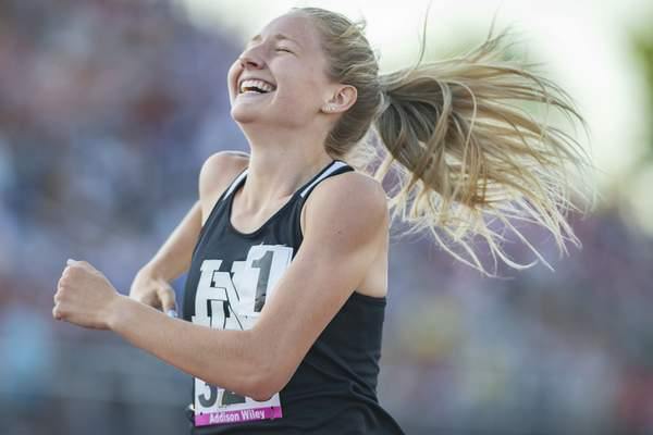 Huntington North's Addison Wiley celebrates as she is crossing the finish as the State Champion in the 800m run at the 2021 IHSAA Girls State Track Meet on June 5, 2021 at Ben Davis High School in Indianapolis, IN. (Credit Image: Chad Williams)