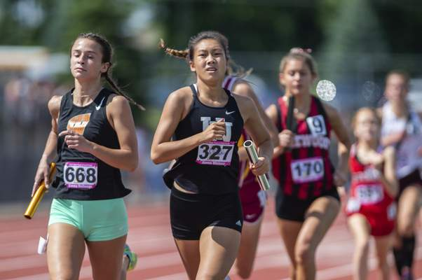Huntinton North's Hanna Whitney competing in the 4X800 relay at the 2021 IHSAA Girls State Track Meet on June 5, 2021 at Ben Davis High School in Indianapolis, IN. (Credit Image: Chad Williams)