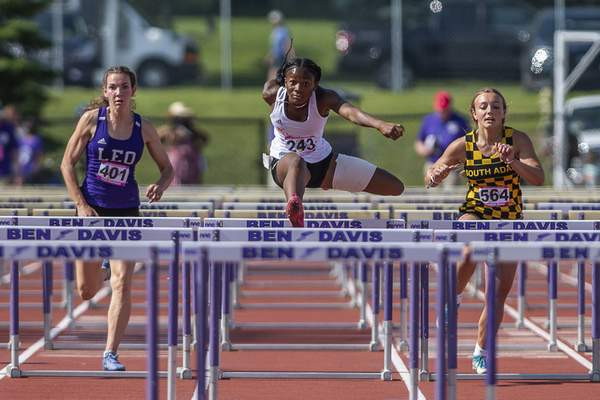 FW Northrup's Morgan Patterson, South Adams's Brooklyn Bixler and Leo's Leah Handshoe compete in the 100m Hurdles at the 2021 IHSAA Girls State Track Meet on June 5, 2021 at Ben Davis High School in Indianapolis, IN. (Credit Image: Chad Williams)
