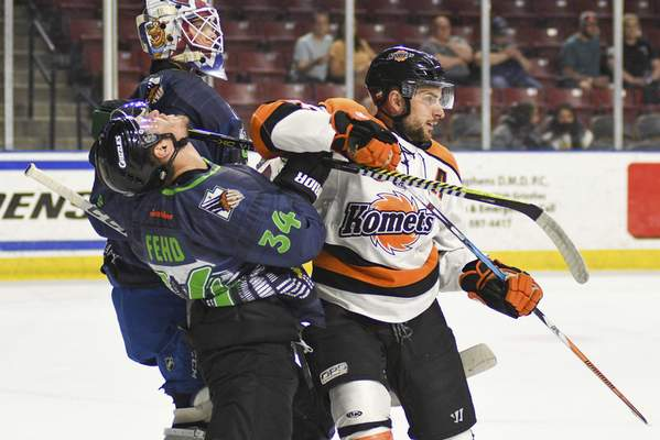 Utah Grizzlies Photography  Komets forward Anthony Petruzzelli, right, battles for position with the Utah Grizzlies' Brandon Fehd on Saturday night in front of the Grizzlies' net at West Valley City, Utah.