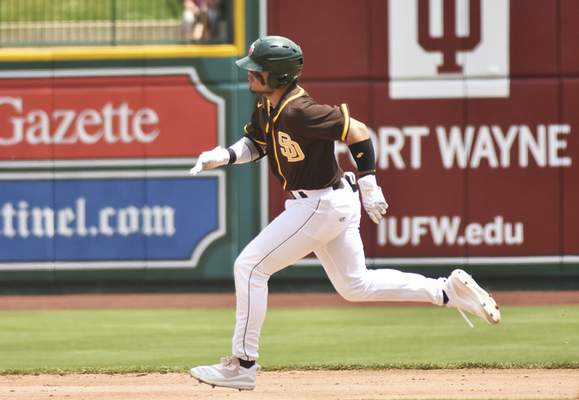 Katie Fyfe | The Journal Gazette  The TinCaps' Tirso Ornelas runs to second base during the second inning against the Kernels at Parkview Field on Sunday.