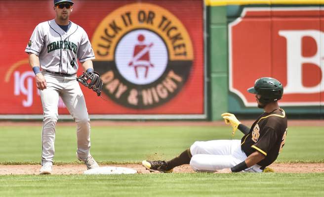 Katie Fyfe | The Journal Gazette  The TinCaps' Justin Lopez slides into second base during the second inning against the Kernels at Parkview Field on Sunday.