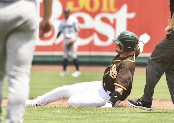Katie Fyfe | The Journal Gazette  The TinCaps' Tirso Ornelas slides into second base during the second inning against the Kernels at Parkview Field on Sunday.