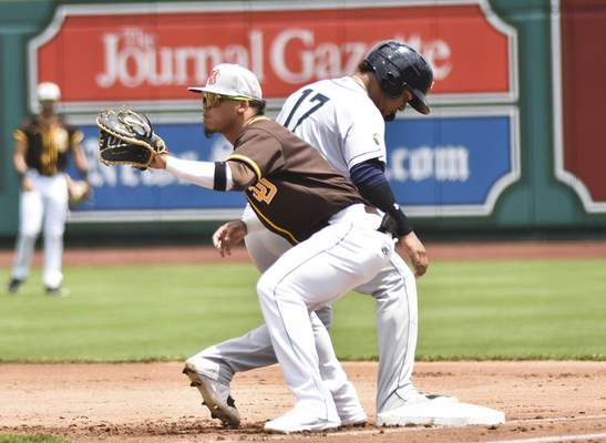 Katie Fyfe | The Journal Gazette  The TinCaps' Luis Almanzar catches the ball as Kernels' Jair Camargo runs back into first base during the second inning at Parkview Field on Sunday.