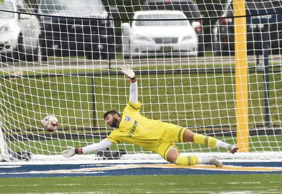 Katie Fyfe   The Journal Gazette  FWFC goalie Joe Bowles dives to block the ball during the first half against South Bend at Shields Field on Sunday.