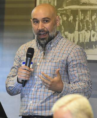 Michelle Davies | The Journal Gazette The Rev. Angelo Mante, executive director of Alive, presented his vision for Peacemaker Academy, a program of nonviolence training, Monday at the Rotary Club of Fort Wayne.