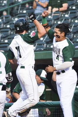 Katie Fyfe | The Journal Gazette  The TinCaps' Johnny Homza celebrates with teammate Kelvin Melean after hitting a home run during the first inning against the Captains at Parkview Field on Tuesday.
