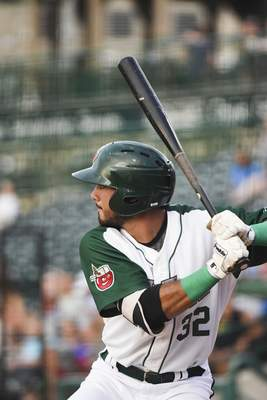 Katie Fyfe | The Journal Gazette  The TinCaps' Agustin Ruiz bats during the fourth inning against the Captains at Parkview Field on Tuesday.