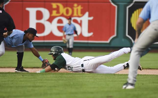 Katie Fyfe | The Journal Gazette  The TinCaps' Agustin Ruiz slides into second base during the fourth inning against the Captains at Parkview Field on Tuesday.