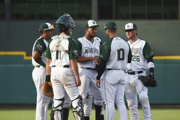 Katie Fyfe | The Journal Gazette  TinCaps players meet on the mound of the field during the third inning and decide to make Edwuin Bencomo the pitcher at Parkview Field on Tuesday.