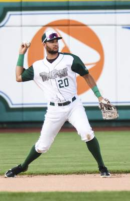 Katie Fyfe | The Journal Gazette  The TinCaps' Justin Lopezgets ready to throwthe ball during the first inning against the Captains at Parkview Field on Tuesday.