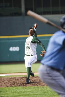 Katie Fyfe | The Journal Gazette  The TinCaps' Edwuin Bencomo pitches inthe third inning against the Captains at Parkview Field on Tuesday.