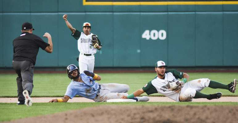 Katie Fyfe | The Journal Gazette  The TinCaps' Justin Lopez gets the out against the Captains' George Valera during the fourth inning at Parkview Field on Tuesday.