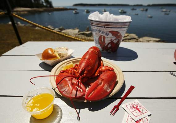FILE - In this Thursday, July 19, 2018, file photo, a lobster is served waterfront at McLoon's Lobster Shack in Spruce Head, Maine. (AP Photo/Robert F. Bukaty, File)