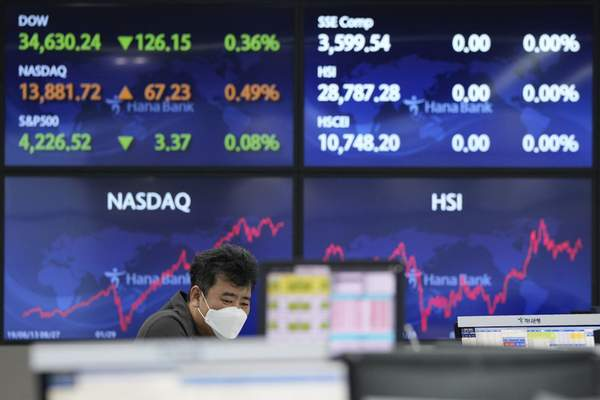 A currency trader watches monitors at the foreign exchange dealing room of the KEB Hana Bank headquarters in Seoul, South Korea, Tuesday, June 8, 2021. (AP Photo/Ahn Young-joon)