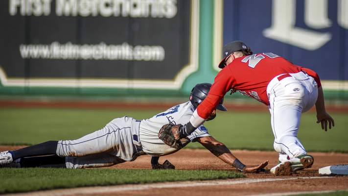 Mike Moore | The Journal Gazette TinCaps first baseman Seamus Curran, right tags out Captains right fielder Quentin Holmes in the first inning at Parkview Field on Wednesday.