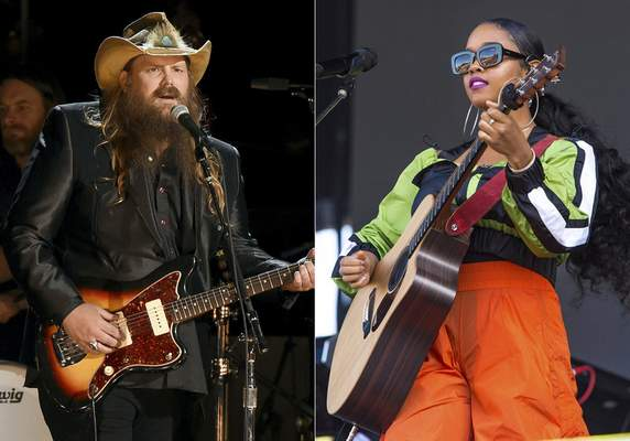 Chris Stapleton performs at the 50th annual CMA Awards on Nov. 2, 2016, in Nashville, Tenn., left, and H.E.R. performs at Lollapalooza on Aug. 1, 2019, in Chicago. (AP Photo)