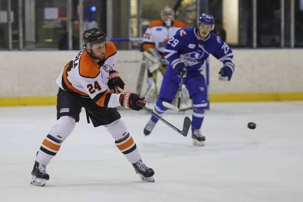 Ed Bailey | Wichita Thunder The Komets' Randy Gazzola chips the puck up the ice Wednesday against the Wichita Thunder. The Komets head back to Memorial Coliseum with the series tied at 1-1.