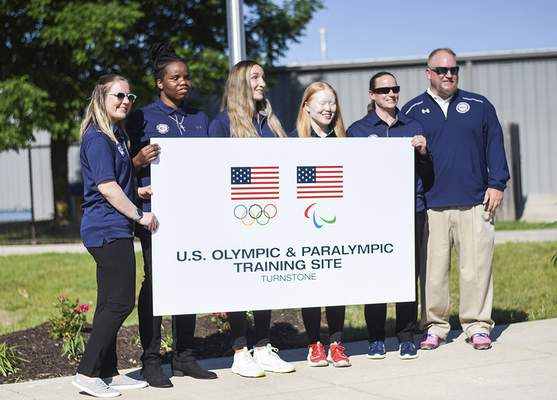 Katie Fyfe | The Journal Gazette Members of the U.S. women's goalball team pose Wednesday behind a banner recognizing Turnstone as an official U.S. Olympic and Paralympic training site.